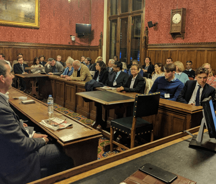 Audience listening to Justine Greening